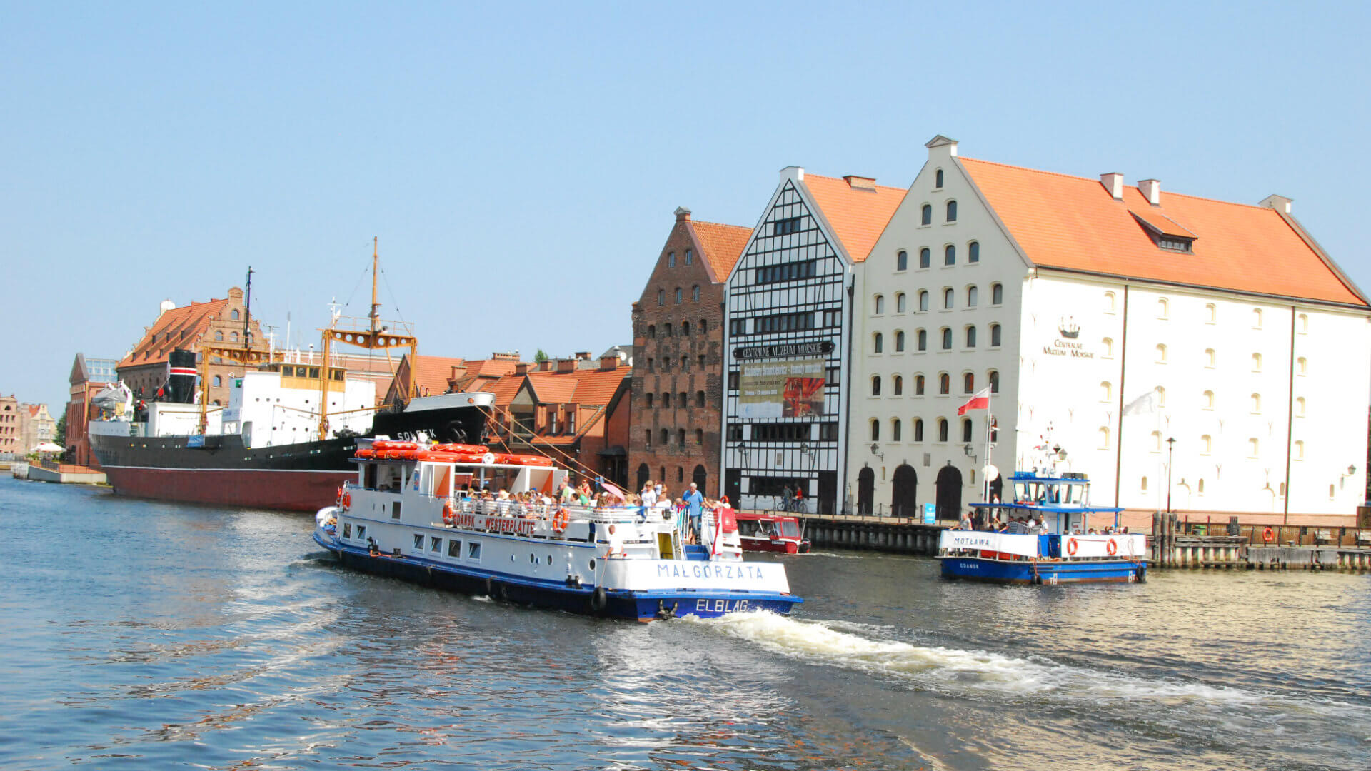 View at the Motława river. Ferries take tourists for boattrips. The buildings were also old granaries.