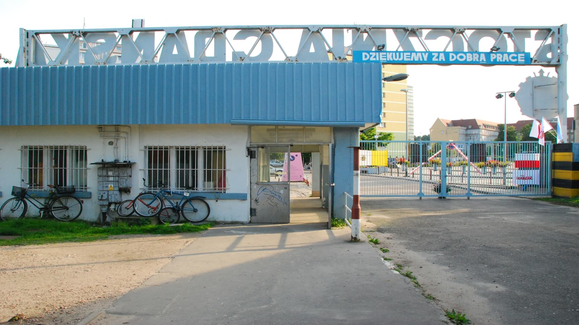 "One of the entrances to the Shipyard. In the golden days thousands of people worked on the shipyards. Before leaving the workers could read the white text on blue background: ""Thank you for the good work""."